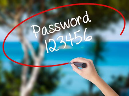 Woman Hand Writing Password 123456 with black marker on visual screen. Isolated on nature. Business concept.