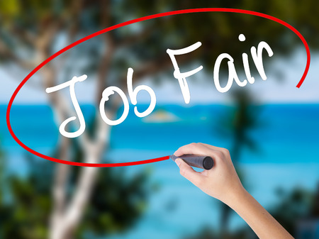 unoccupied: Woman Hand Writing Job Fair with black marker on visual screen. Isolated on nature. Business concept. Stock Photo