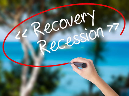 road to recovery: Woman Hand Writing  Recovery - Recession with black marker on visual screen. Isolated on nature. Business concept. Stock Photo Stock Photo