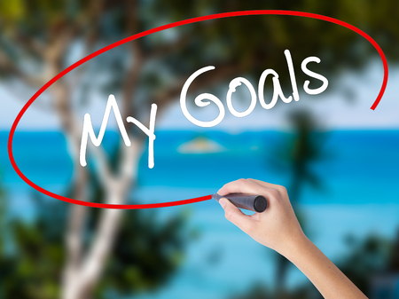Woman Hand Writing  My Goals with black marker on visual screen. Isolated on nature. Business concept. Stock Photo