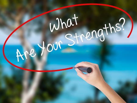 Woman Hand Writing What Are Your Strengths? with black marker on visual screen. Isolated on nature. Business concept. Stock Photo Stock Photo