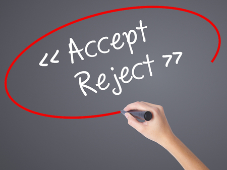 Woman Hand Writing Accept - Reject  with black marker on visual screen. Isolated on grey. Business concept. Stock Photo