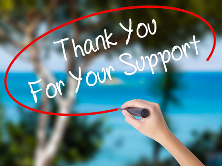 Woman Hand Writing Thank you For Your Support  with black marker on visual screen. Isolated on nature. Business concept. Stock Photo