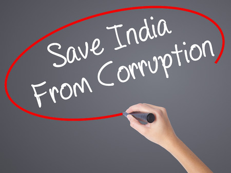 marchers: Woman Hand Writing Save India From Corruption with black marker on visual screen. Isolated on grey. Business concept. Stock Photo Stock Photo