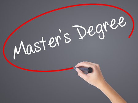 master degree: Woman Hand Writing Masters Degree with black marker on visual screen. Isolated on grey. Business concept. Stock Photo