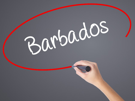 lucia: Woman Hand Writing Barbados  with black marker on visual screen. Isolated on grey. Business concept. Stock Photo Stock Photo