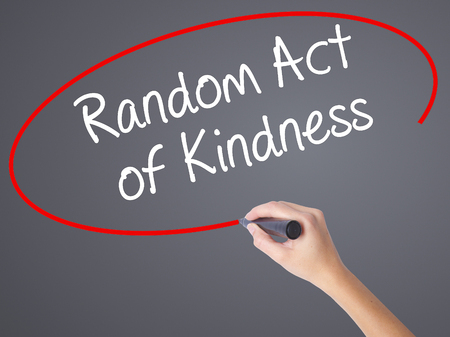 helpfulness: Woman Hand Writing Random Act of Kindness with black marker on visual screen. Isolated on grey. Business concept. Stock Photo Stock Photo