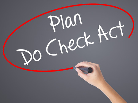 plan do check act: Woman Hand Writing Plan Do Check Act  with black marker on visual screen. Isolated on grey. Business concept. Stock Photo