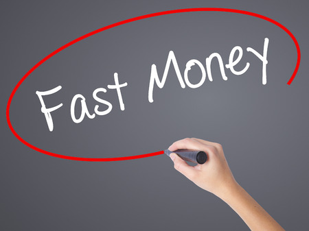 earn google: Woman Hand Writing Fast Money  with black marker on visual screen. Isolated on grey. Business concept. Stock Photo