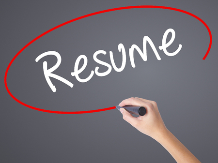 require: Woman Hand Writing Resume with black marker on visual screen. Isolated on grey. Business concept. Stock Photo