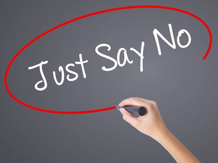 anarchist: Woman Hand Writing Just Say No with black marker on visual screen. Isolated on grey. Business concept. Stock Photo