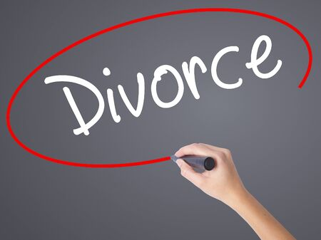 ex wife: Woman Hand Writing Divorce  with black marker on visual screen. Isolated on grey. Business concept. Stock Photo Stock Photo
