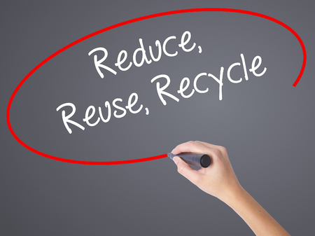 reduce reutiliza recicla: Woman Hand Writing Reduce Reuse Recycle with black marker on visual screen. Isolated on grey. Business concept. Stock Photo