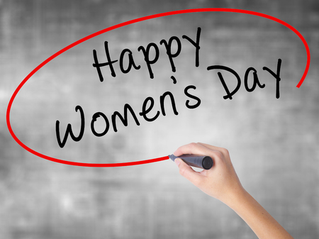greeting cards International Women s Day: Man Hand writing Happy Womens Day with black marker on visual screen. Isolated on white. Business, technology, internet concept. Stock Image