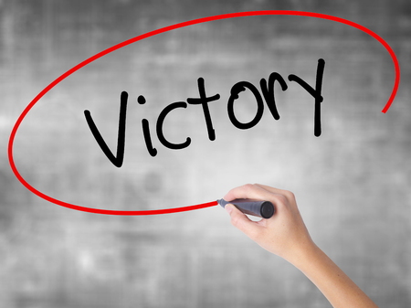 aspirational: Man Hand writing Victory  with black marker on visual screen. Isolated on background. Business, technology, internet concept. Stock Photo Stock Photo