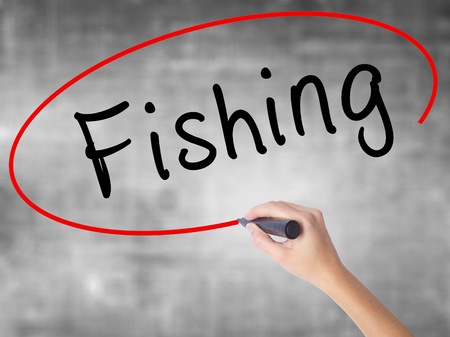 Man Hand writing Fishing with black marker on visual screen. Isolated on white. Business, technology, internet concept. Stock Image Stock Photo