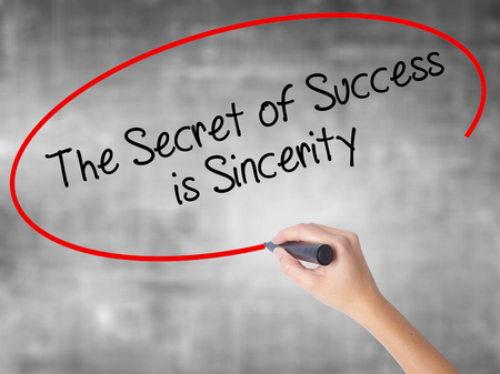esteemed: Woman Hand Writing The Secret of Success is Sincerity with black marker over transparent board. Isolated on grey. Business concept. Stock Photo Stock Photo