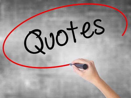 Woman Hand Writing Quotes  with black marker over transparent board. Isolated on grey. Business concept. Stock Photo