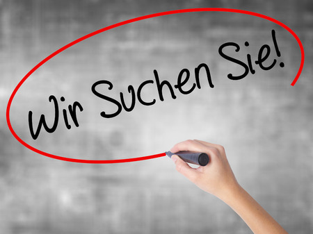 Man Hand writing Wir Suchen Sie! (Looking For You in German) with black marker on visual screen. Isolated on background. Business,  technology, internet concept. Stock Photo