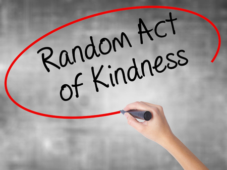helpfulness: Woman Hand Writing Random Act of Kindness with black marker over transparent board. Isolated on grey. Business concept. Stock Photo Stock Photo