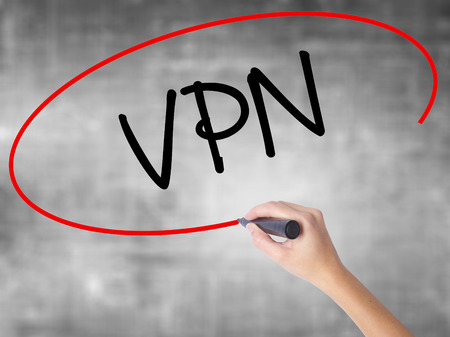 Man Hand writing VPN (Virtual Private Network) with black marker on visual screen. Isolated on background. Business, technology, internet concept. Stock Photo