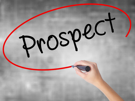 prospector: Woman Hand Writing Prospect with black marker over transparent board. Isolated on grey. Business concept. Stock Photo Foto de archivo
