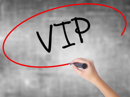 Man Hand writing  VIP with black marker on visual screen. Isolated on background. Business, technology, internet concept. Stock Photo Stock Photo