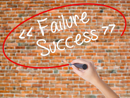 Woman Hand Writing Failure Success with black marker on visual screen. Isolated on bricks. Business concept. Stock Photo Stock Photo