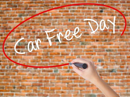 Woman Hand Writing Car Free Day with black marker on visual screen. Isolated on bricks. Business concept. Stock Photo Stock Photo