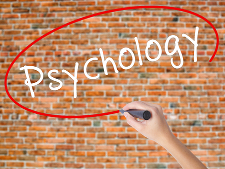 antisocial: Woman Hand Writing Psychology with black marker on visual screen. Isolated on bricks. Business concept. Stock Photo