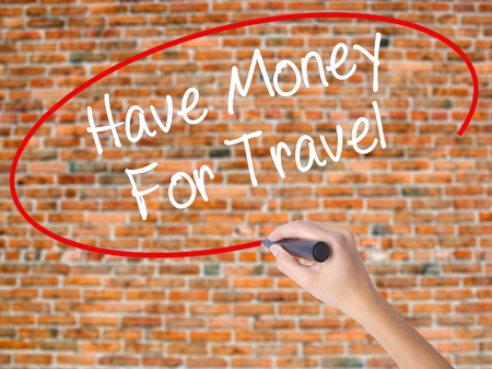 Woman Hand Writing Have Money For Travel  with black marker on visual screen. Isolated on bricks. Business concept. Stock Photo Stock Photo