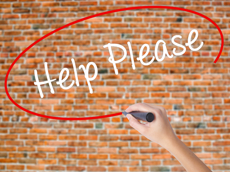 Woman Hand Writing Help Please with black marker on visual screen. Isolated on bricks. Business concept. Stock Photo