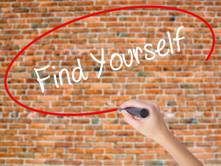 Woman Hand Writing Find Yourself with black marker on visual screen. Isolated on bricks. Business concept. Stock Photo Stock Photo