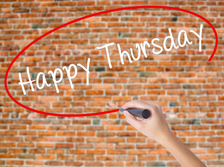 Woman Hand Writing Happy Thursday with black marker on visual screen. Isolated on bricks. Business, technology, internet concept. Stock  Photo Stock Photo