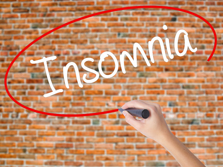 hallucinations: Woman Hand Writing Insomnia  with black marker on visual screen. Isolated on bricks. Business concept. Stock Photo Stock Photo