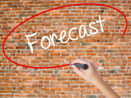 Woman Hand Writing Forecast with black marker on visual screen. Isolated on bricks. Business concept. Stock Photo Stock Photo