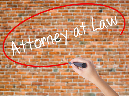 rightfulness: Woman Hand Writing Attorney at Law with black marker on visual screen. Isolated on bricks. Business concept. Stock Photo Stock Photo