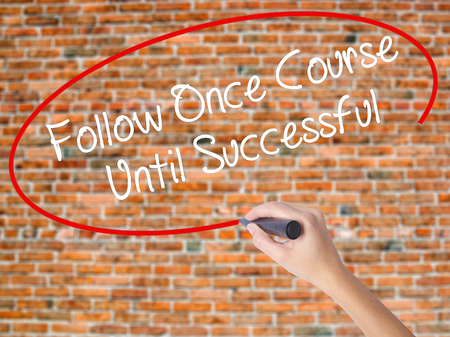 Woman Hand Writing Follow Once Course Until Successful with black marker on visual screen. Isolated on bricks. Business concept. Stock Photo Stock Photo