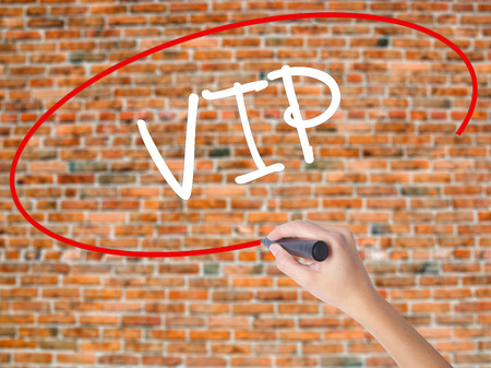 computer club: Woman Hand Writing  VIP with black marker on visual screen. Isolated on bricks. Business concept. Stock Photo Stock Photo