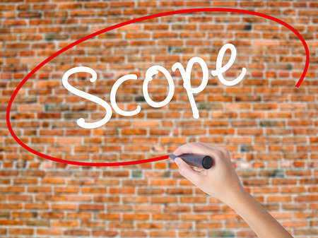 Woman Hand Writing Scope with black marker on visual screen. Isolated on bricks. Business concept. Stock Photo Stock Photo