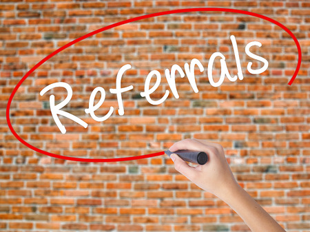 affiliation: Woman Hand Writing Referrals with black marker on visual screen. Isolated on bricks. Business concept. Stock Photo