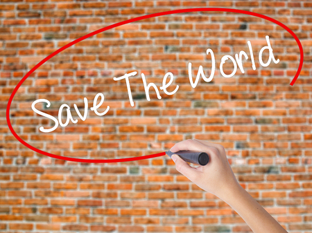 paperless: Woman Hand Writing Save The World with black marker on visual screen. Isolated on bricks. Business, technology, internet concept. Stock  Photo