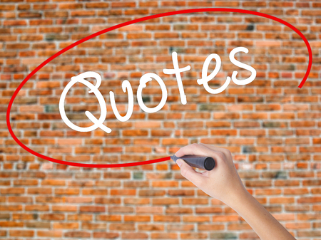 Woman Hand Writing Quotes  with black marker on visual screen. Isolated on bricks. Business concept. Stock Photo Stock Photo