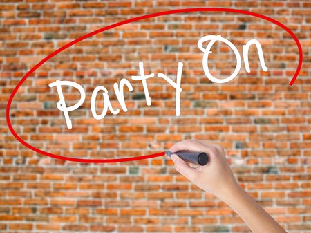 strip club: Woman Hand Writing Party On with black marker on visual screen. Isolated on bricks. Business concept. Stock Photo Stock Photo