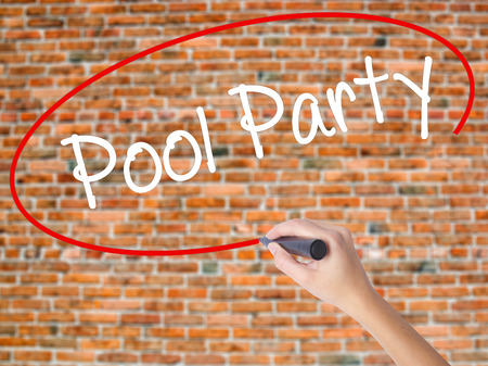 Woman Hand Writing Pool Party with black marker on visual screen. Isolated on bricks. Business, technology, internet concept. Stock Photo Stock Photo