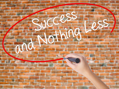 work less: Woman Hand Writing Success and Nothing Less with black marker on visual screen. Isolated on bricks. Business concept. Stock Photo Stock Photo