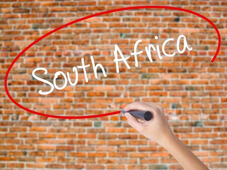 Woman Hand Writing South Africa with black marker on visual screen. Isolated on bricks. Business concept. Stock Photo Stock Photo