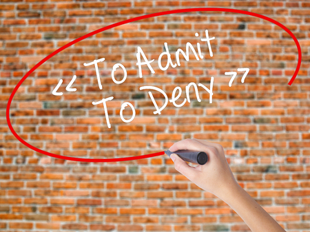 denying: Woman Hand Writing To Admit - To Deny with black marker on visual screen. Isolated on bricks. Business concept. Stock Photo Stock Photo