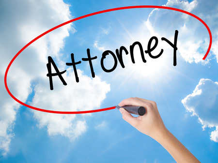 Woman Hand Writing Attorney  with black marker on visual screen. Isolated on Sunny Sky. Business concept. Stock Photo