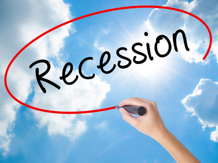 Woman Hand Writing Recession with black marker on visual screen. Isolated on Sunny Sky. Business concept. Stock Photo Stock Photo